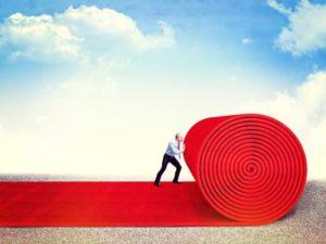 17602280 - man roll huge red carpet